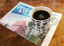 Kuvituskuva kahvikupista Jyväskylä-lehden päällä