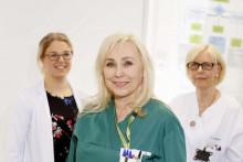 Lääkäri ja hoitajat terveysasemalla